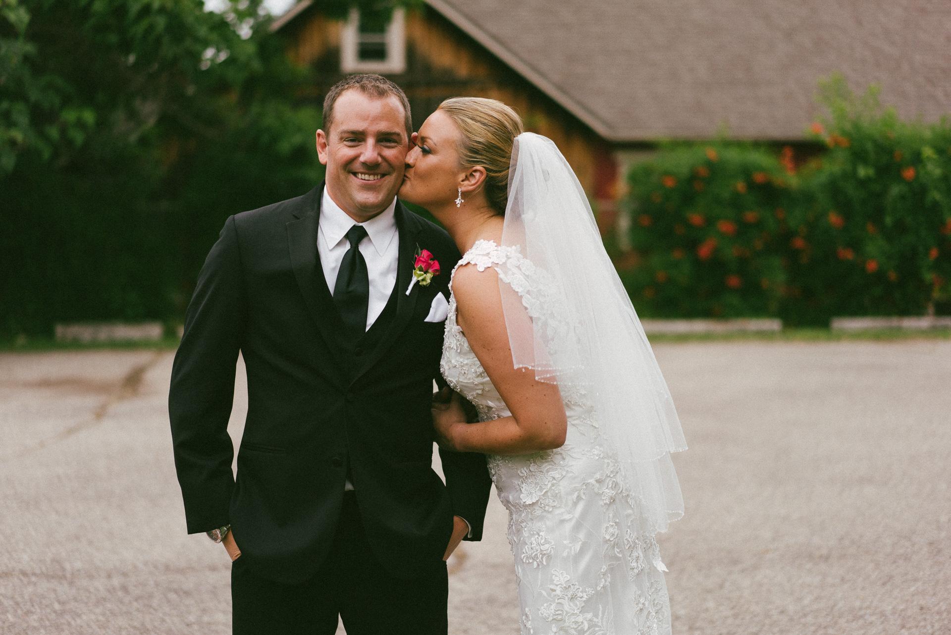 Dayton Wedding Photographer - Bride kissing Groom