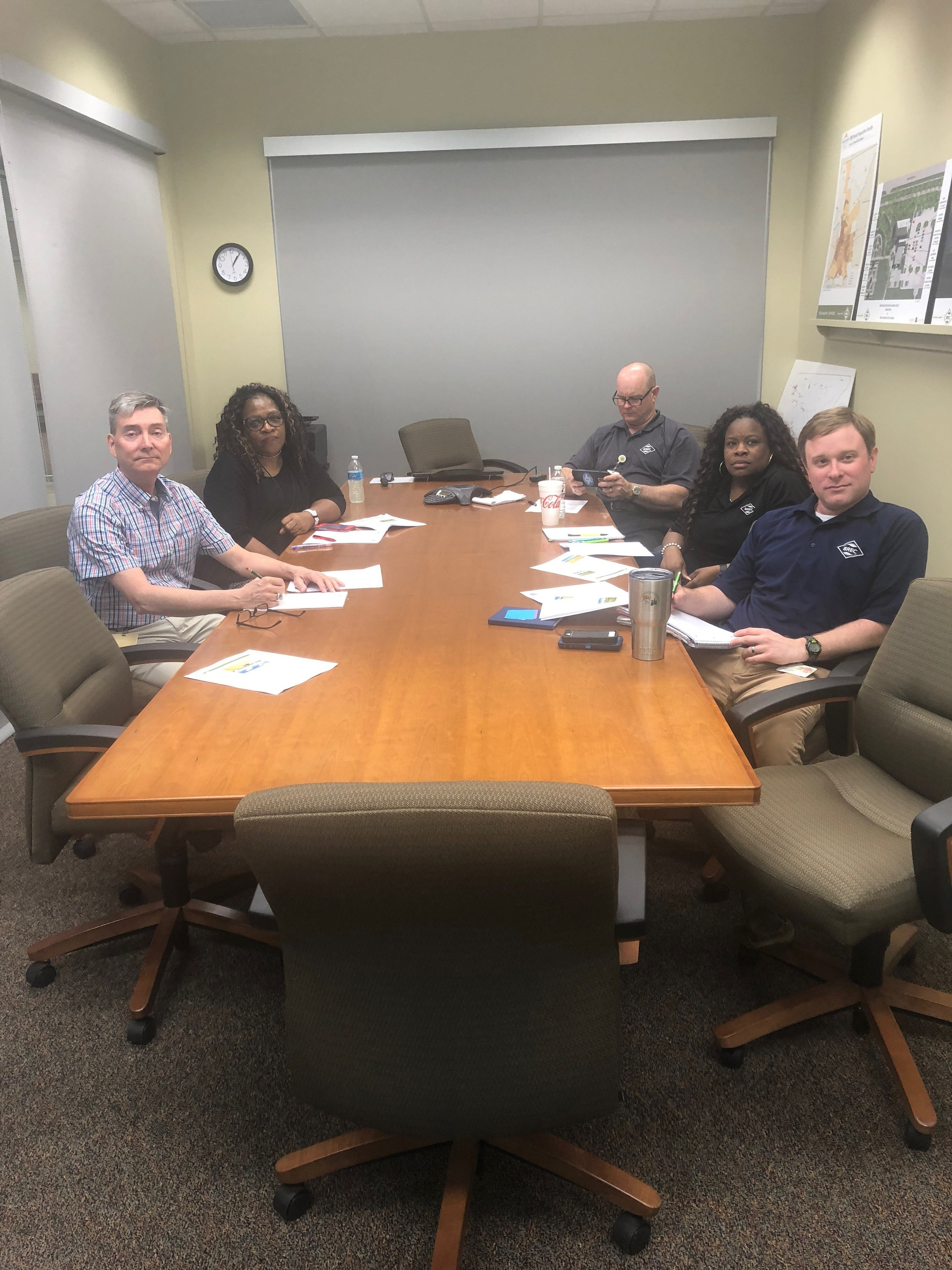 """""""Pictured clockwise from the left, BREC Foundation Executive Director, Carl Stages, BREC Assistant Director of Evaluation and Partnership Development, Diane Drake, BREC Assistant Director of Recreation (Athletics), Brett Weinberger, BREC Program Coordinator (Athletics), DeVeta Webb, and BREC Program Coordinator of Evaluation and Partnership Development, Michael King, participate in a webinar on the NFL Foundation Grassroots Program which awarded a $50,000 grant for lighting of the playing field behind the BREC Administration Building."""""""