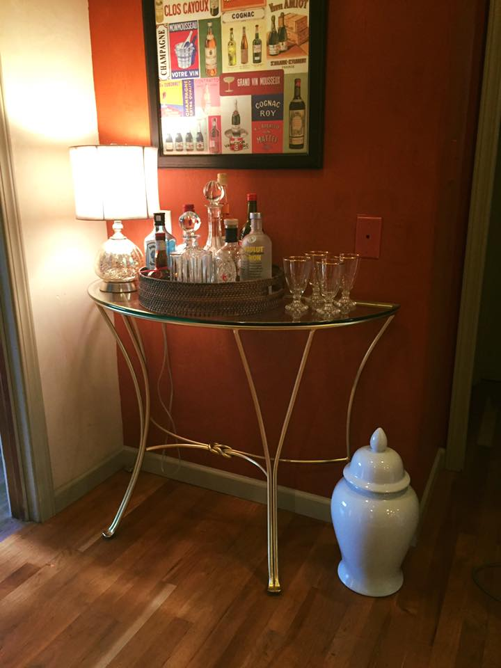 I painted an old table I had as my bar gold and I LOVE it!