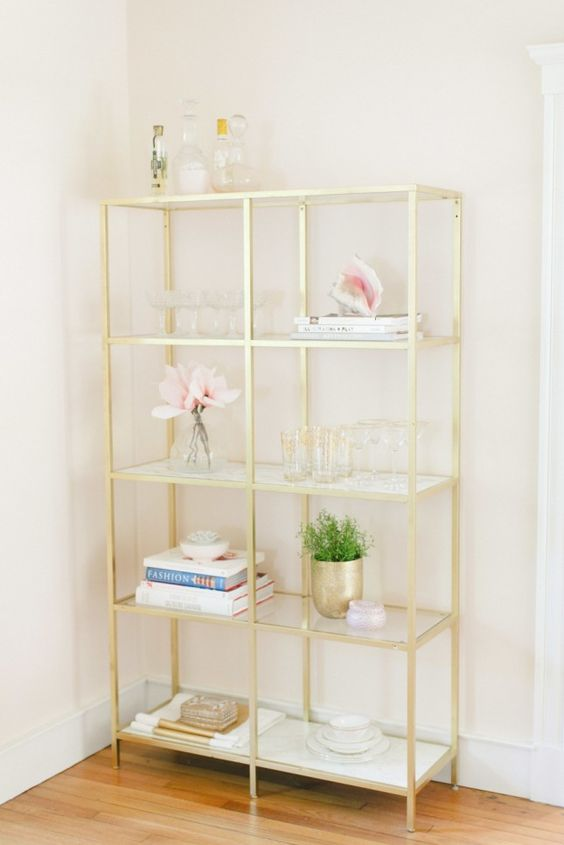 Cannot go wrong with a gold bookcase!