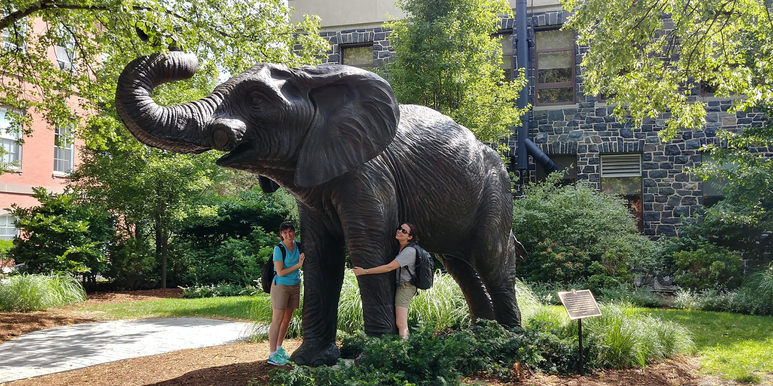 Rachael and Marie pay homage to Jumbo on Tufts Medford campus.