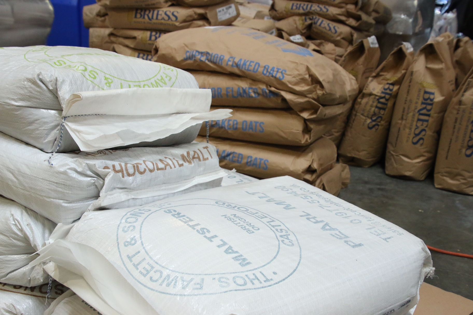 These bags of malt will soon transform into pints of beer