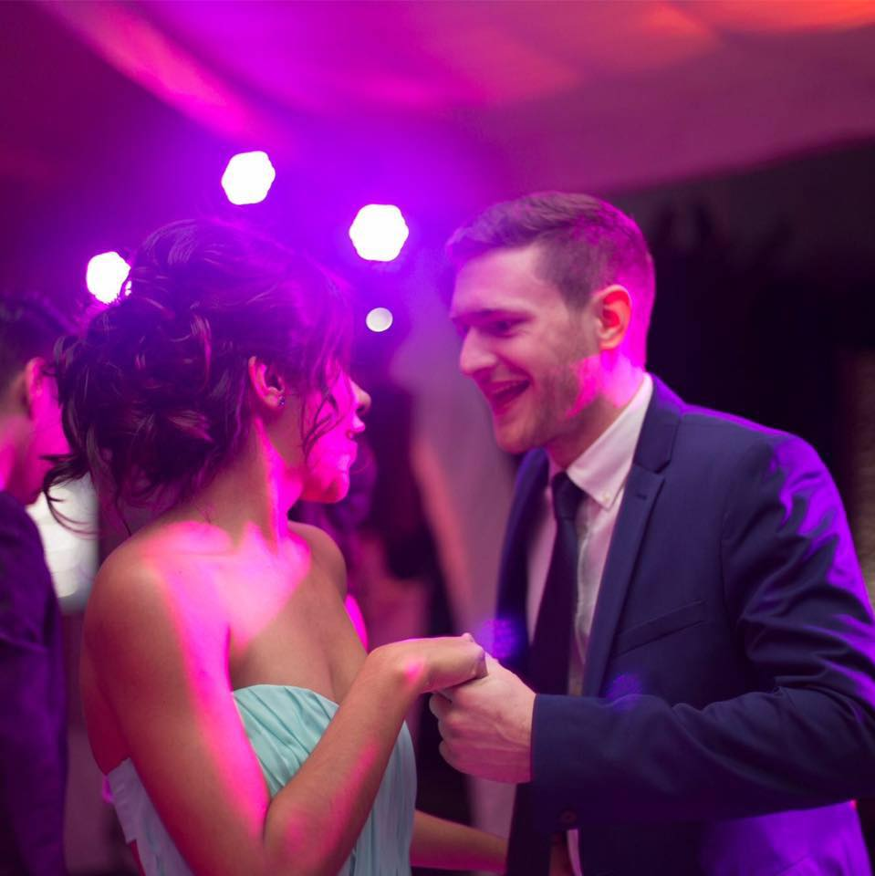 The photographers caught us showing off our best moves at a friend's wedding in México.