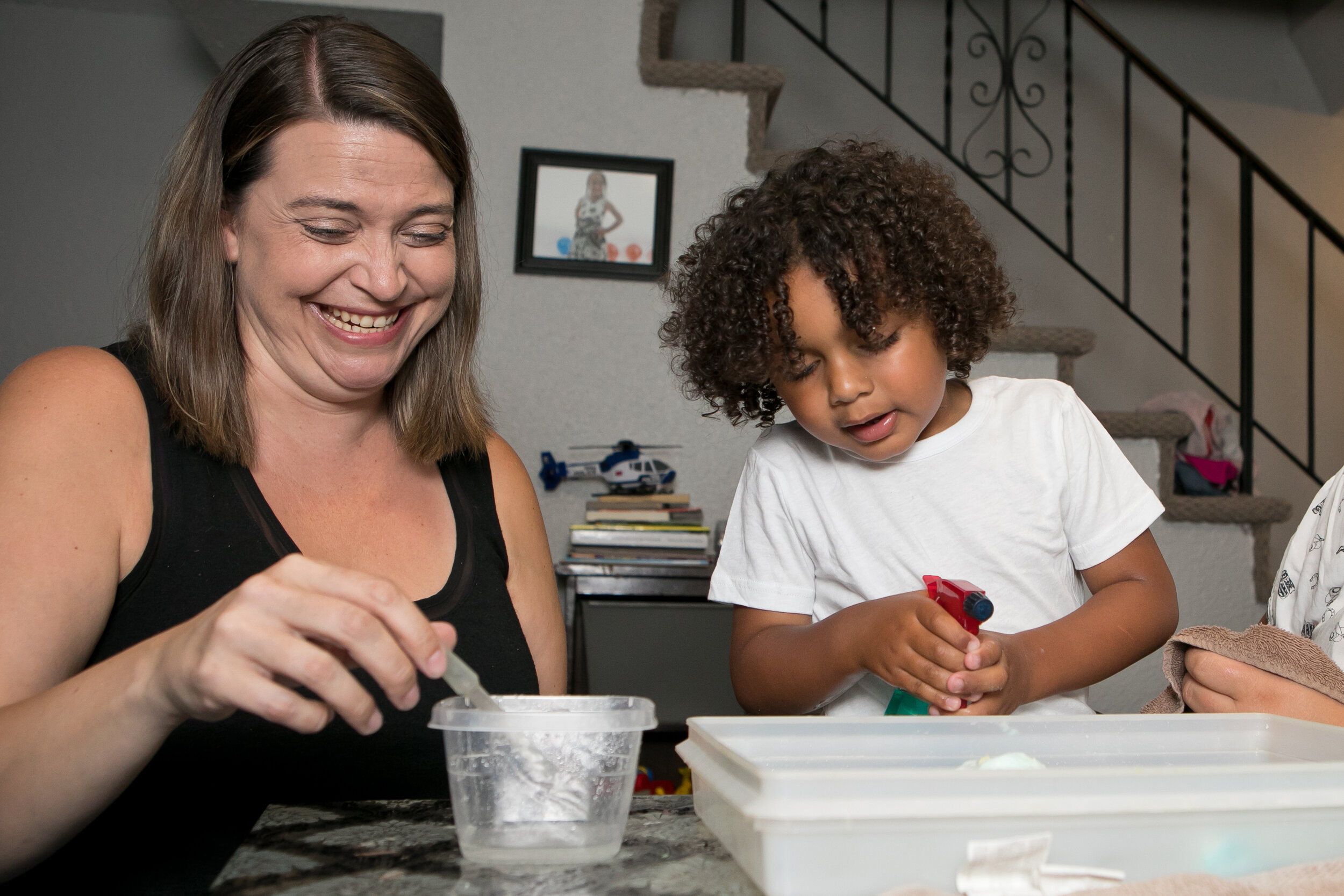 Andrea and Dezmond do an art activity during a home visit.