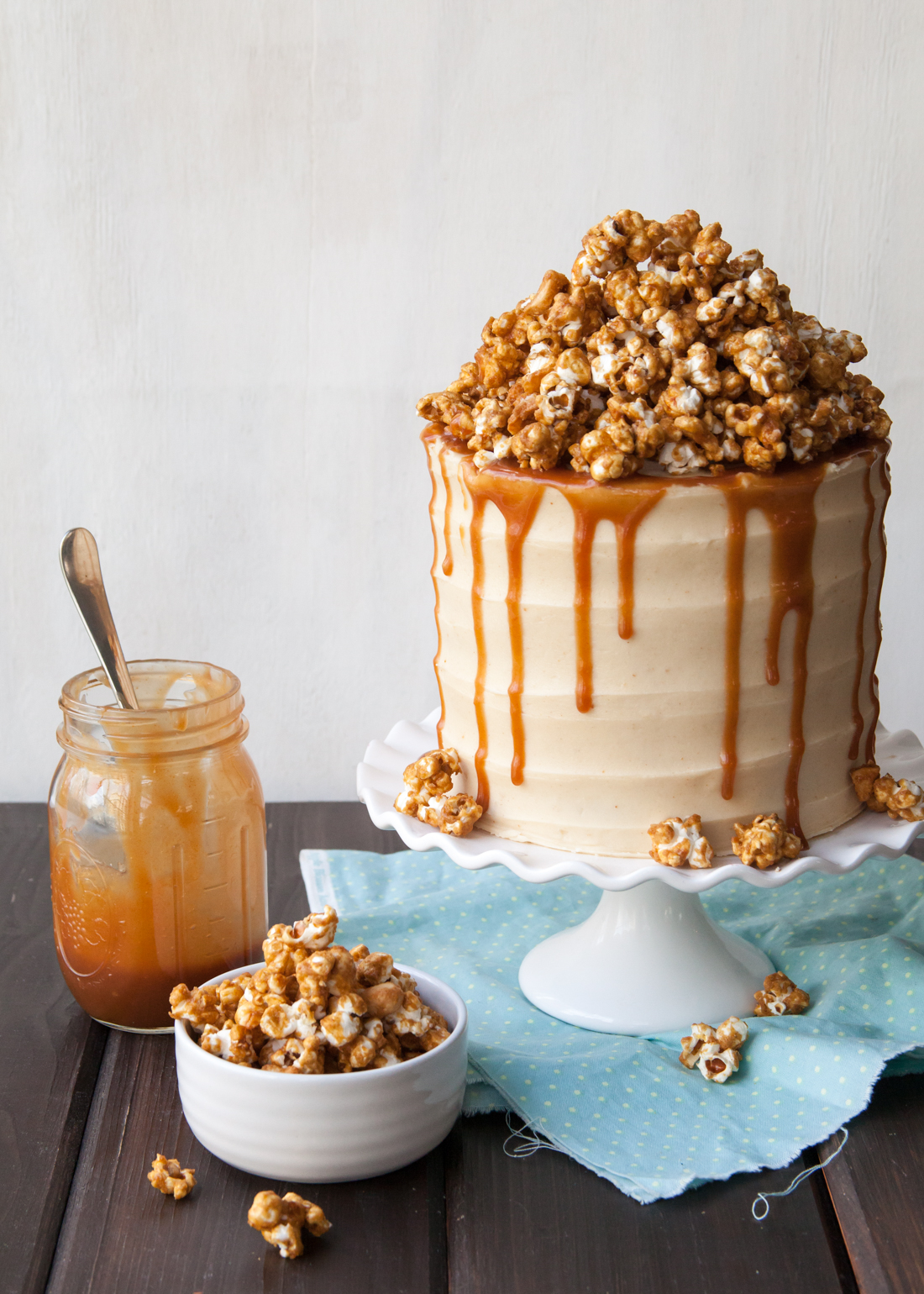 Caramel Popcorn Cake Recipe with brown butter cake and peanut butter frosting.