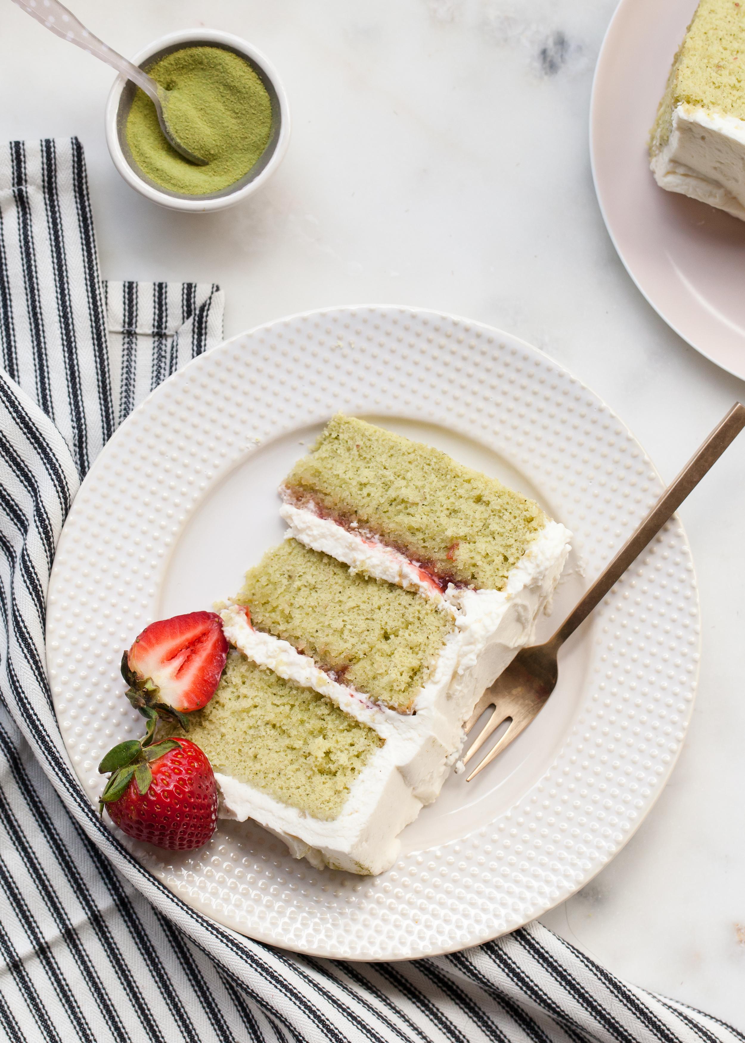Matcha (green tea) genoise cake with strawberries and cream cheese whipped cream.