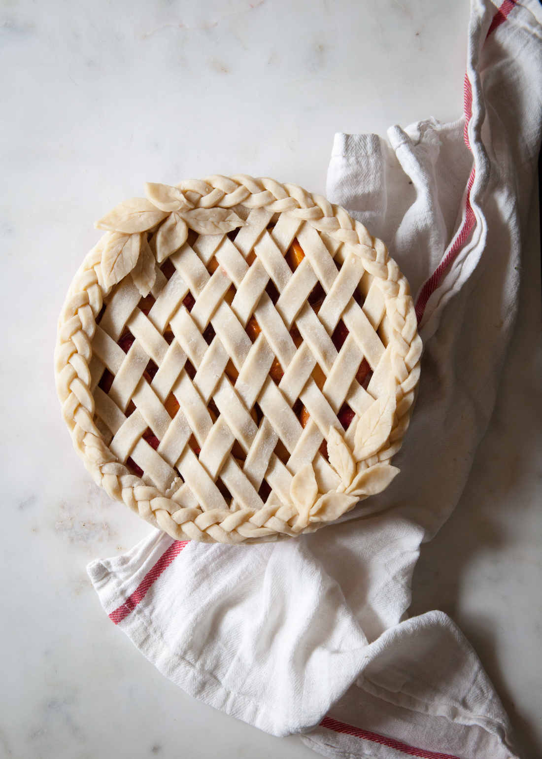 Apricot Raspberry Pie with an all butter crust and braided, lattice design.