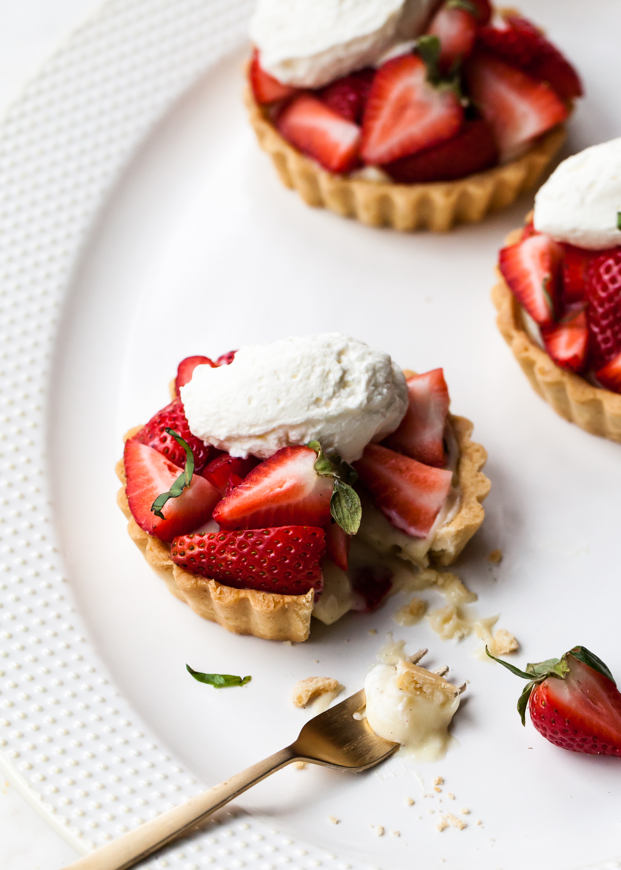 Strawberry Basil Tartlets with vanilla pastry cream.