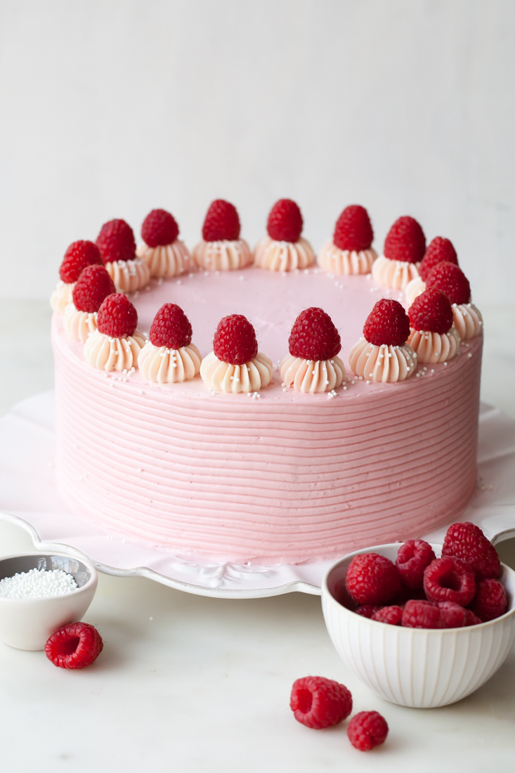 Chocolate Raspberry Layer Cake with jam and raspberry cheesecake buttercream.  Perfect for Valentine's Day!