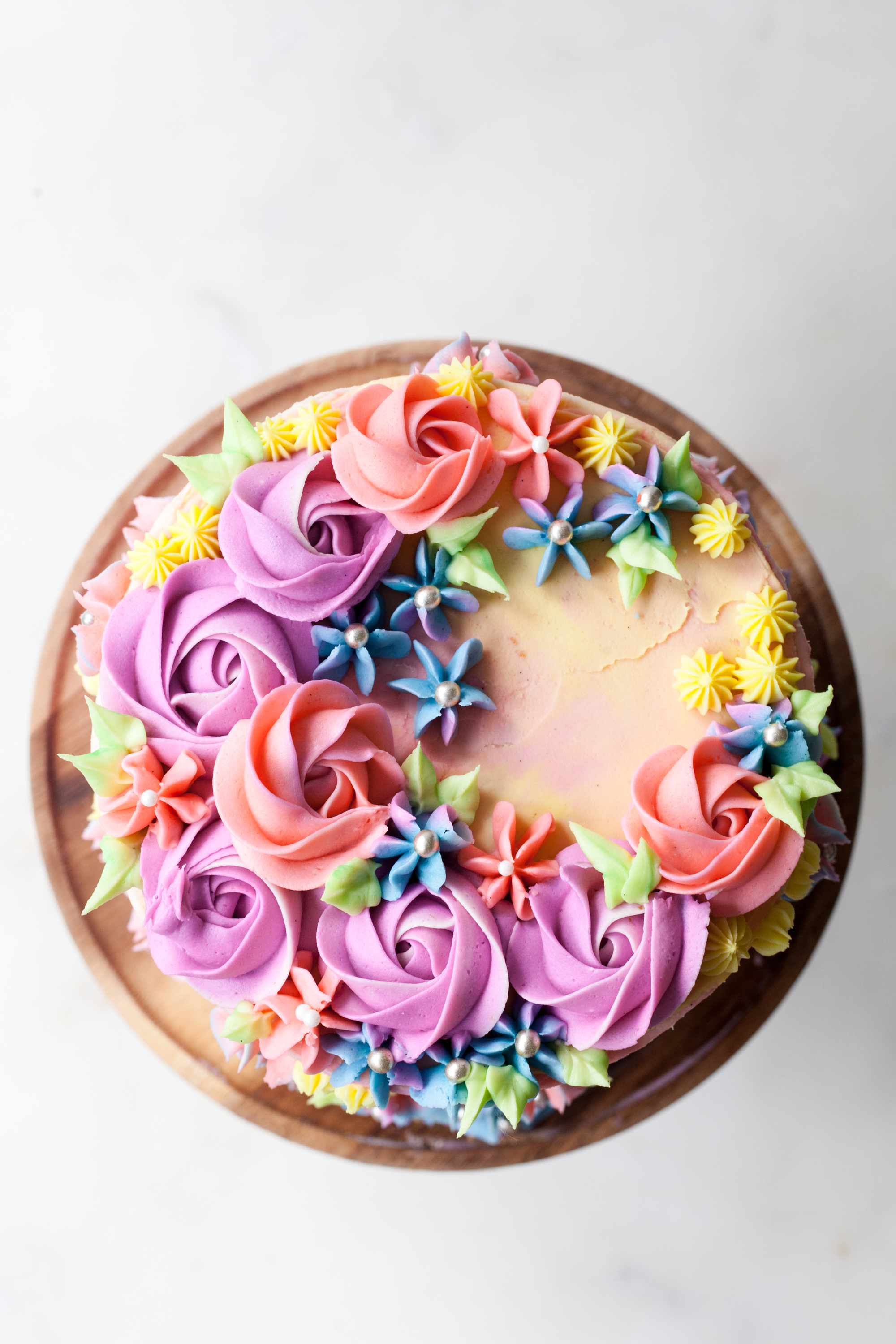 Sprinkle Birthday Cake with vanilla pastel buttercream swirls