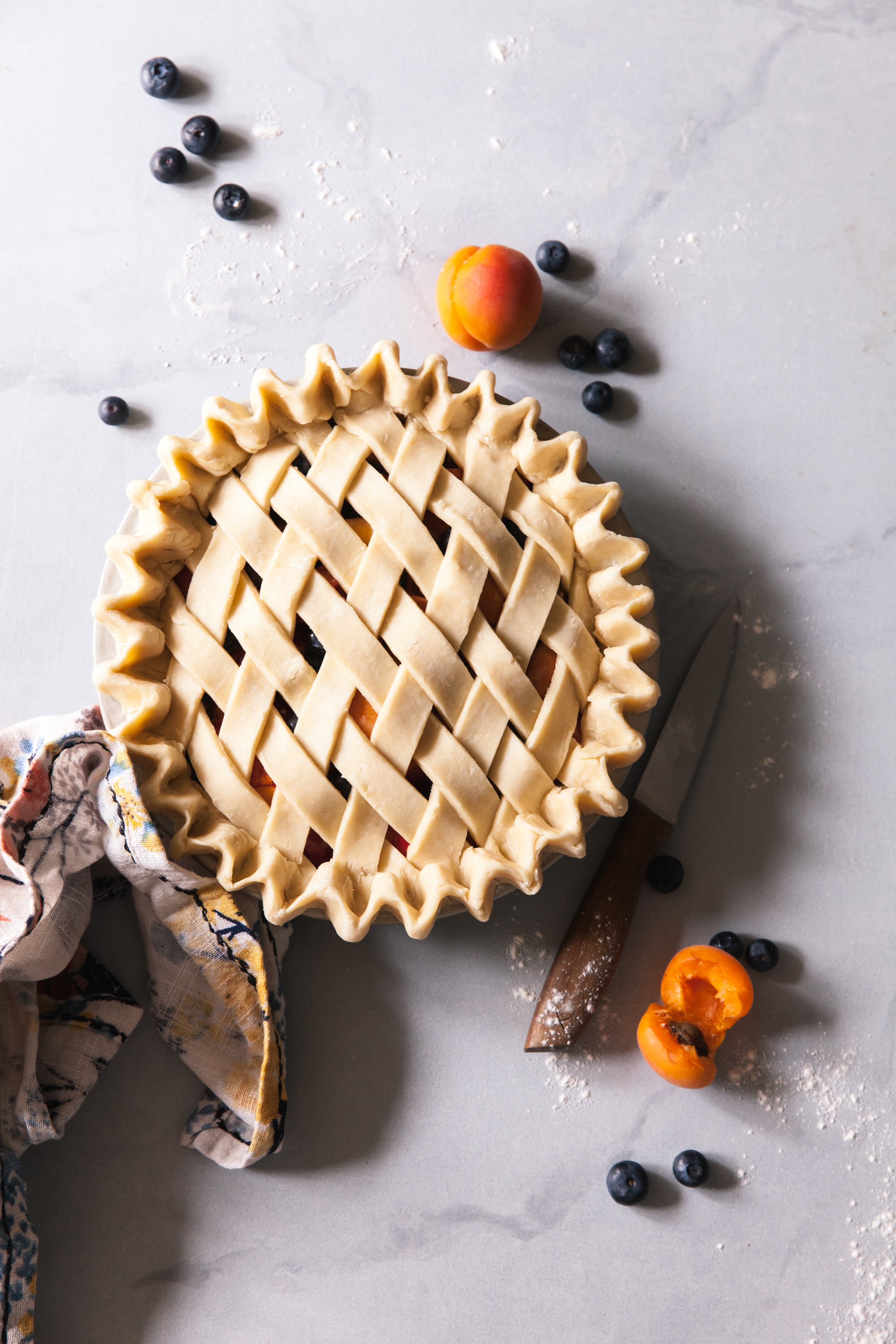 Blueberry Peach Pie Recipe with apricots and lattice crust.