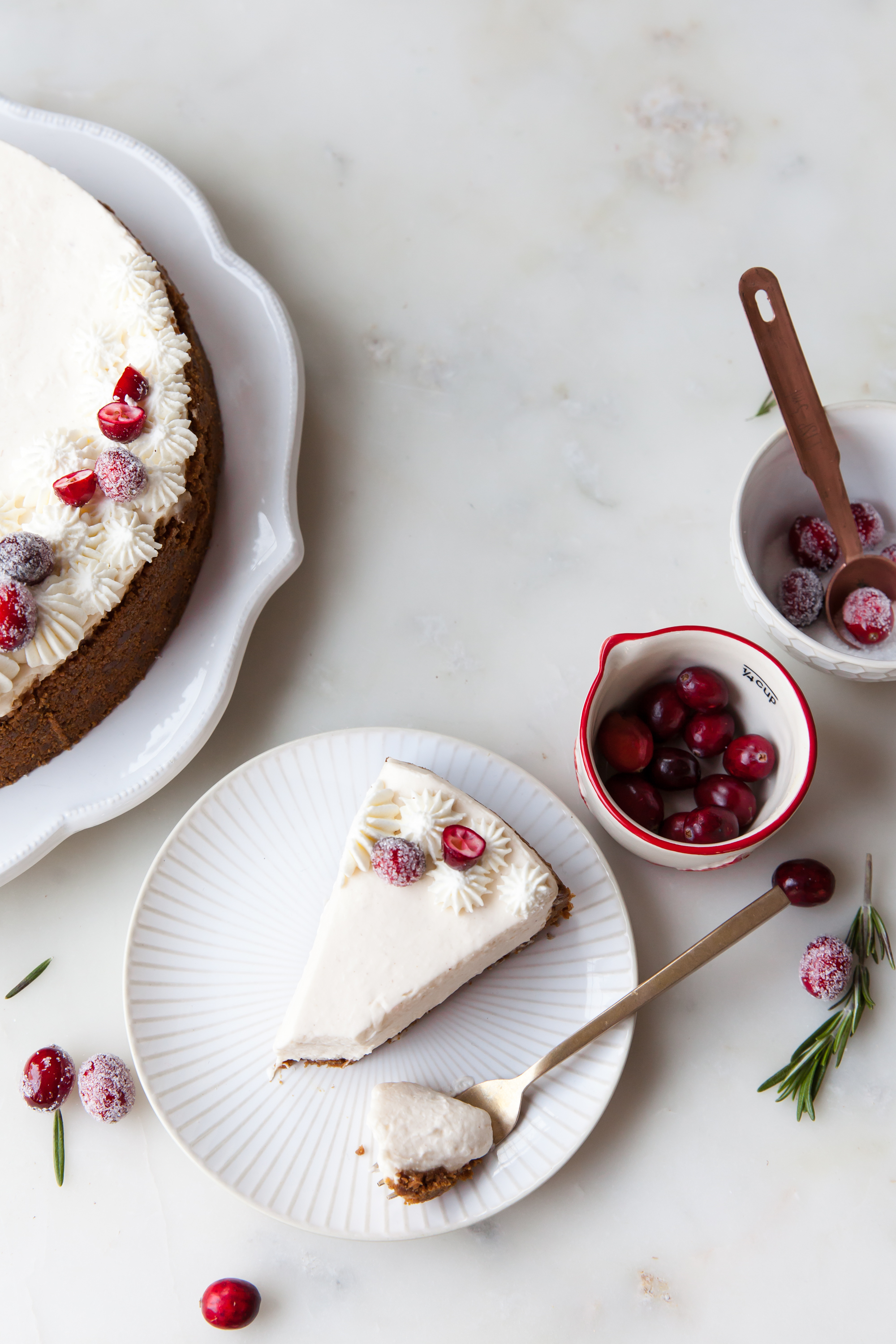 No-Bake Eggnog Cheesecake with sugared cranberries and gingersnap crust.