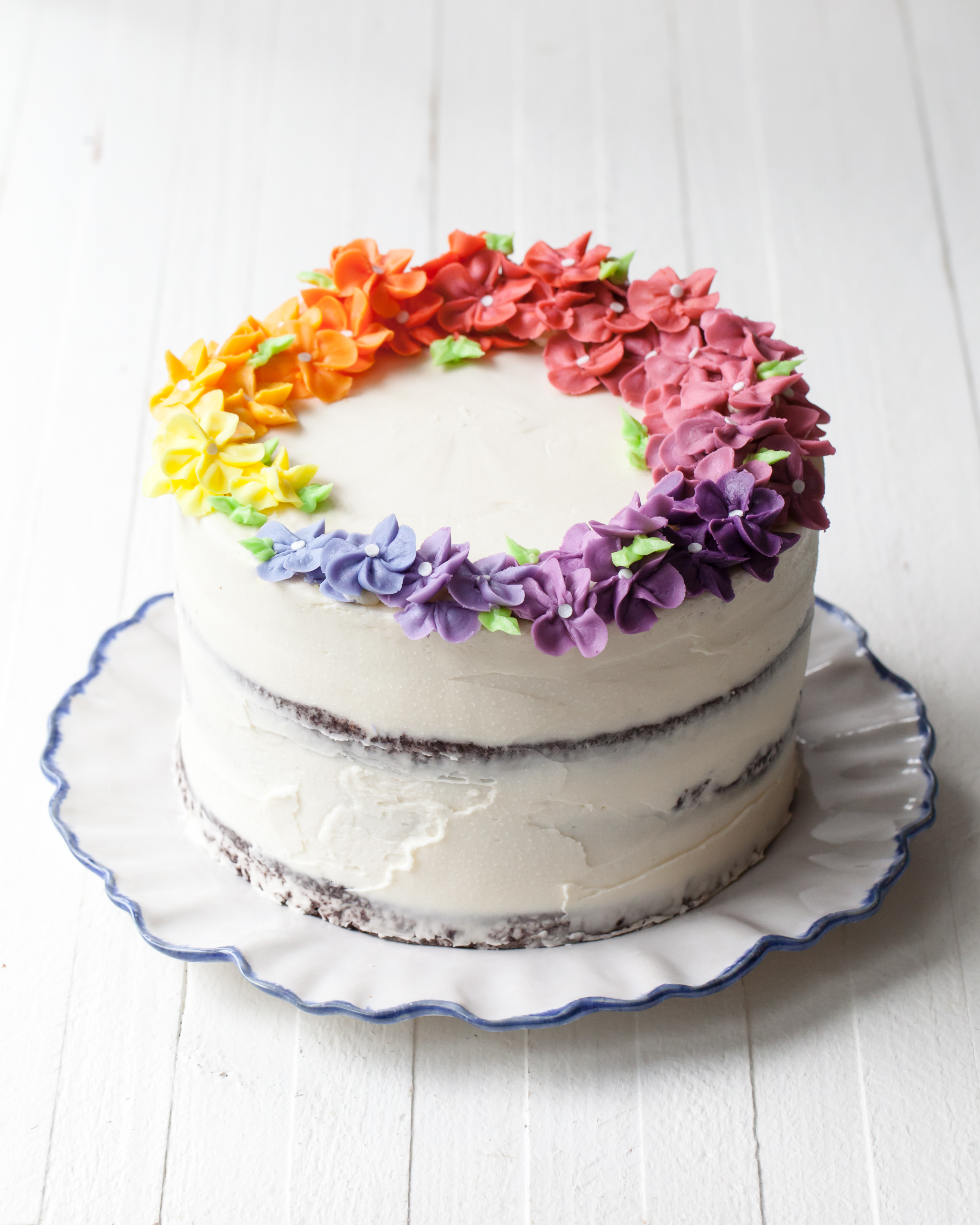 How to make a rainbow cake with layers of eggless chocolate cake and peanut butter filling