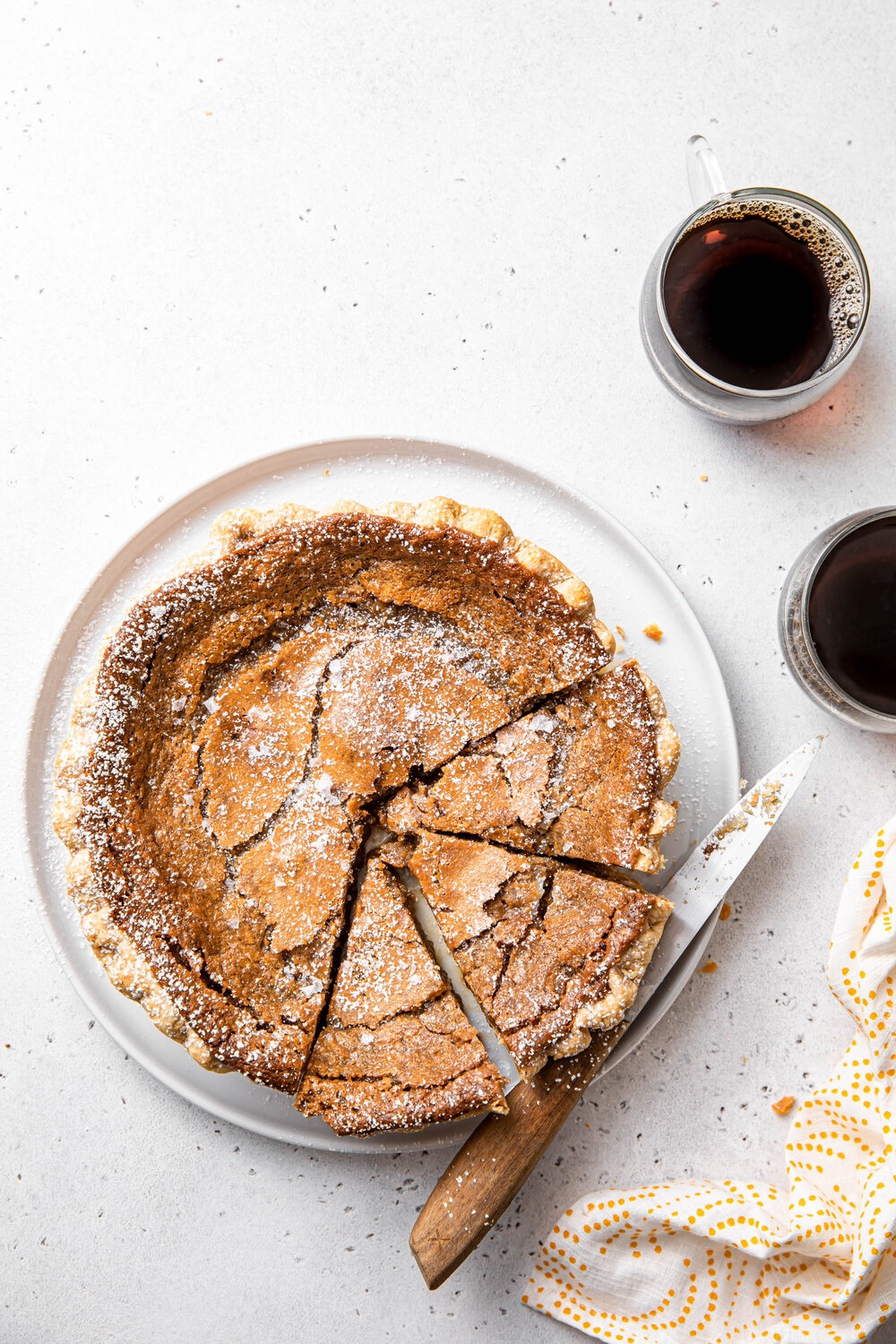 A French Canadian Maple Sugar Pie with powdered sugar on top.