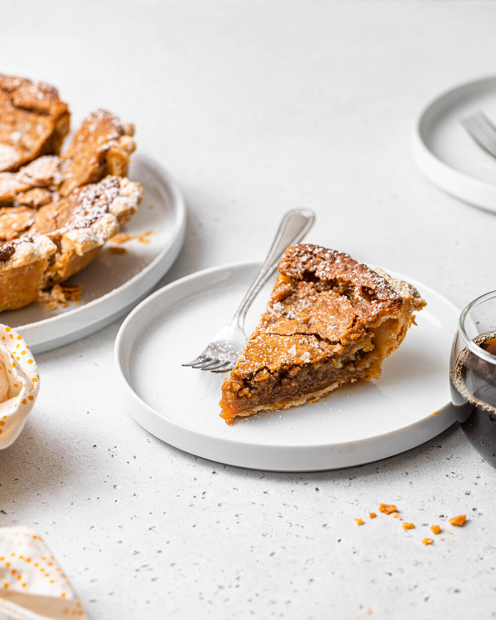 Slice of maple sugar pie with flaky crust and gooey brown sugar filling.