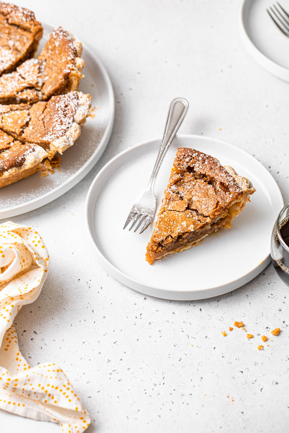 A slice of French Canadian Maple Sugar Pie with a gooey, brown sugar filling and crispy top.
