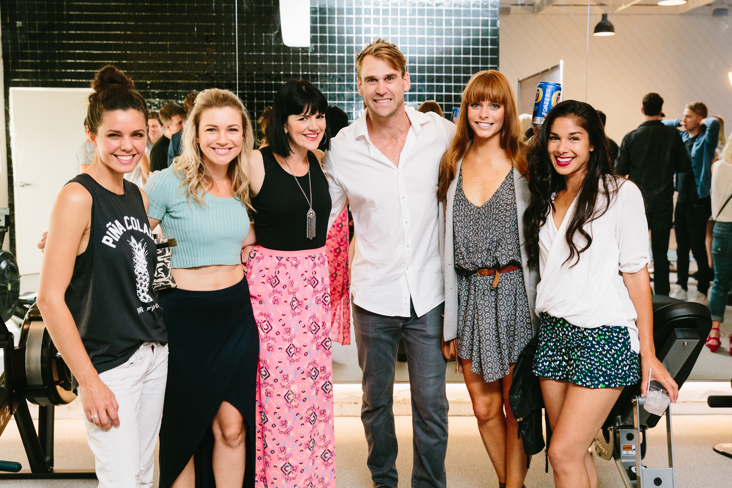 Luke Milton along with Chloe Hurst (on Luke's left) and other guests