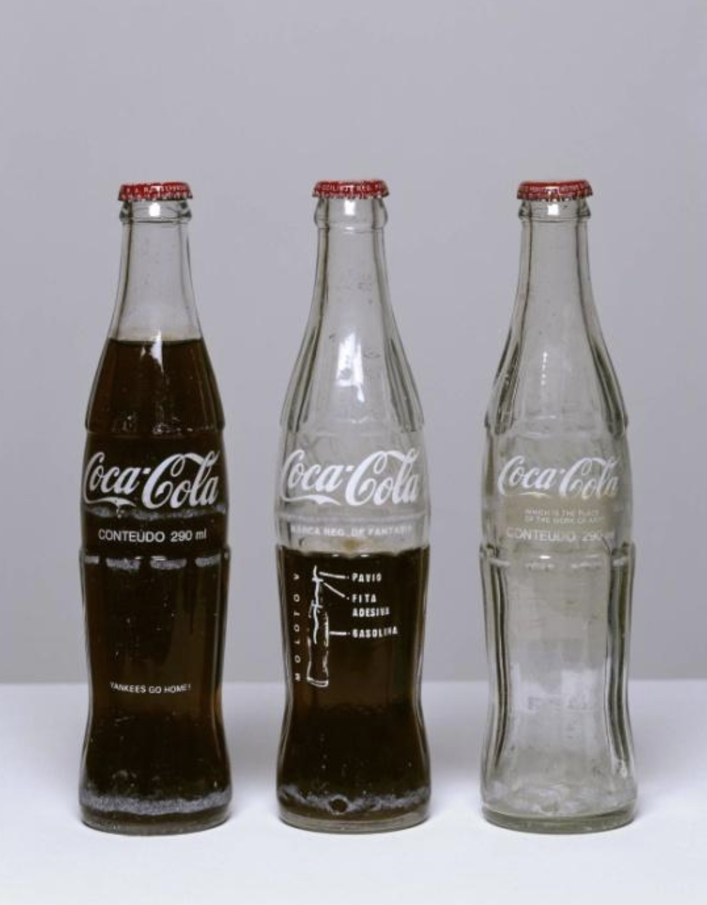 Cildo Mereles, I nsertations into Idealogical Circuits: Coca-Cola Project  (1970) Glass bottles with adhesive labels Tate