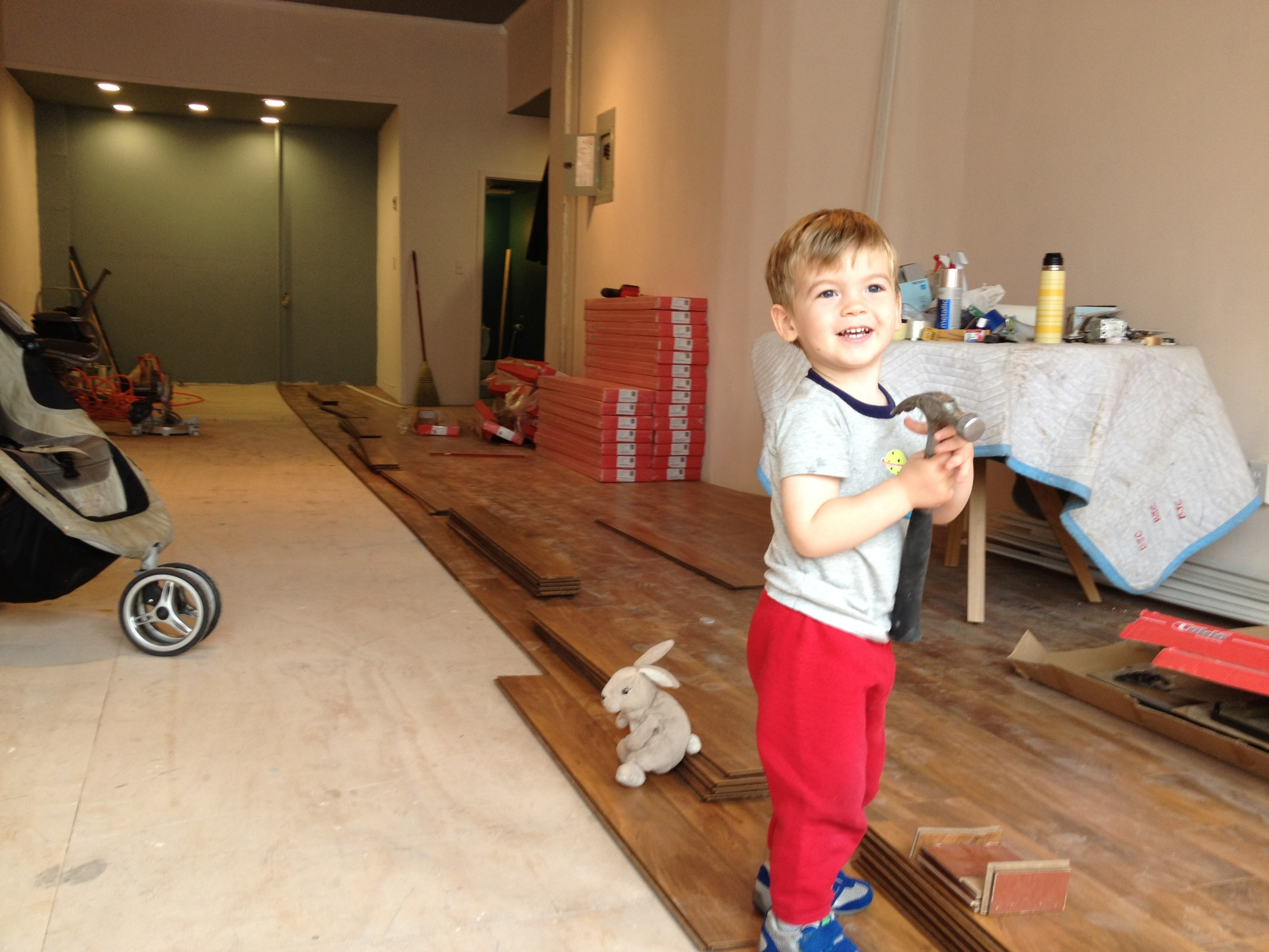 A growing boy (and his bunny) helping to renovate his Mama's first storefront studio in 2013