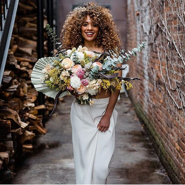 Big flowers, big hair, on POINT! Love those locks @risepowell 💖  Florals by @studiorhea Photo by @wildescoutphoto.co Hair by @andriatobeyhair (and God) makeup by @alexaraemakeup_ Silk crepe trousers by us 😉