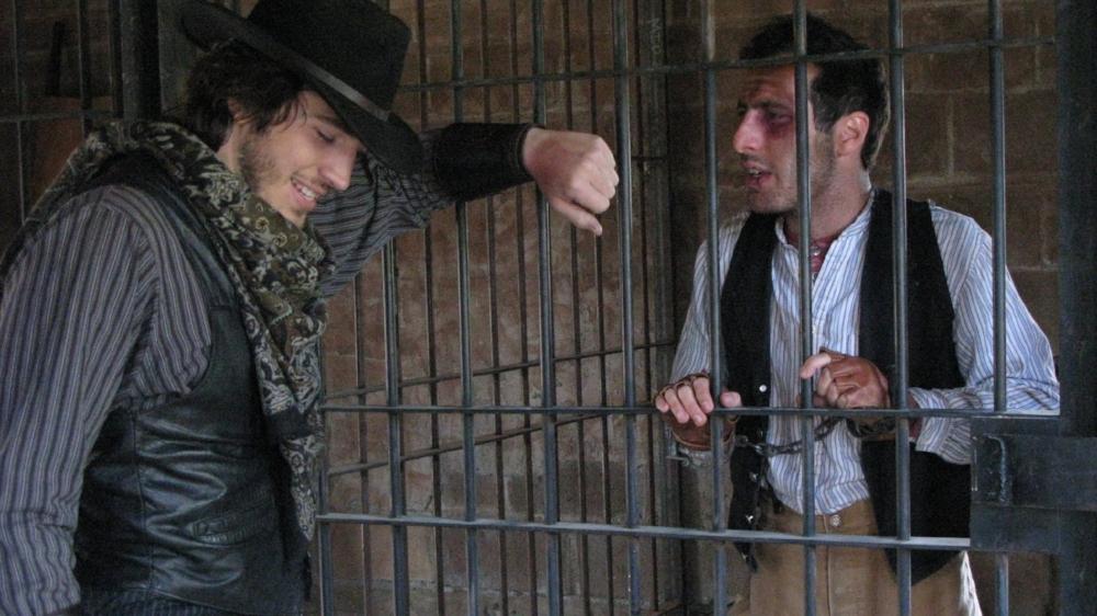 Adam Gold as Jim Lockhart interviewing Luke Tyler (Noah Woods) in VERMIJO