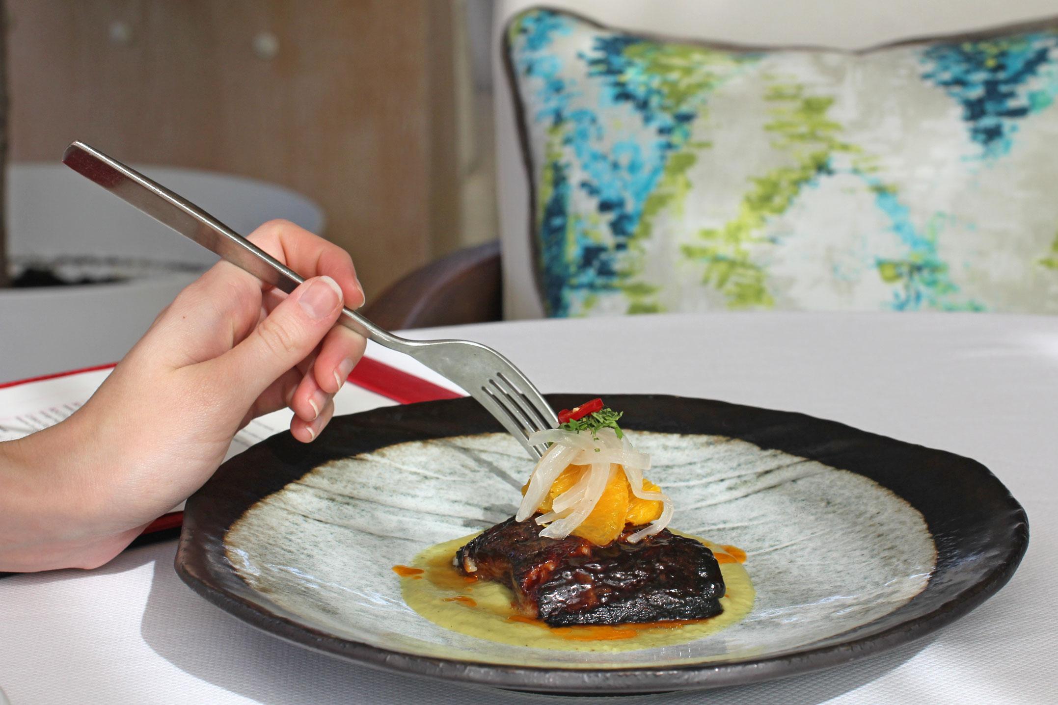 ROCOTO MISO GLAZED BLACK COD,avocado poblano purée, orange mojo.