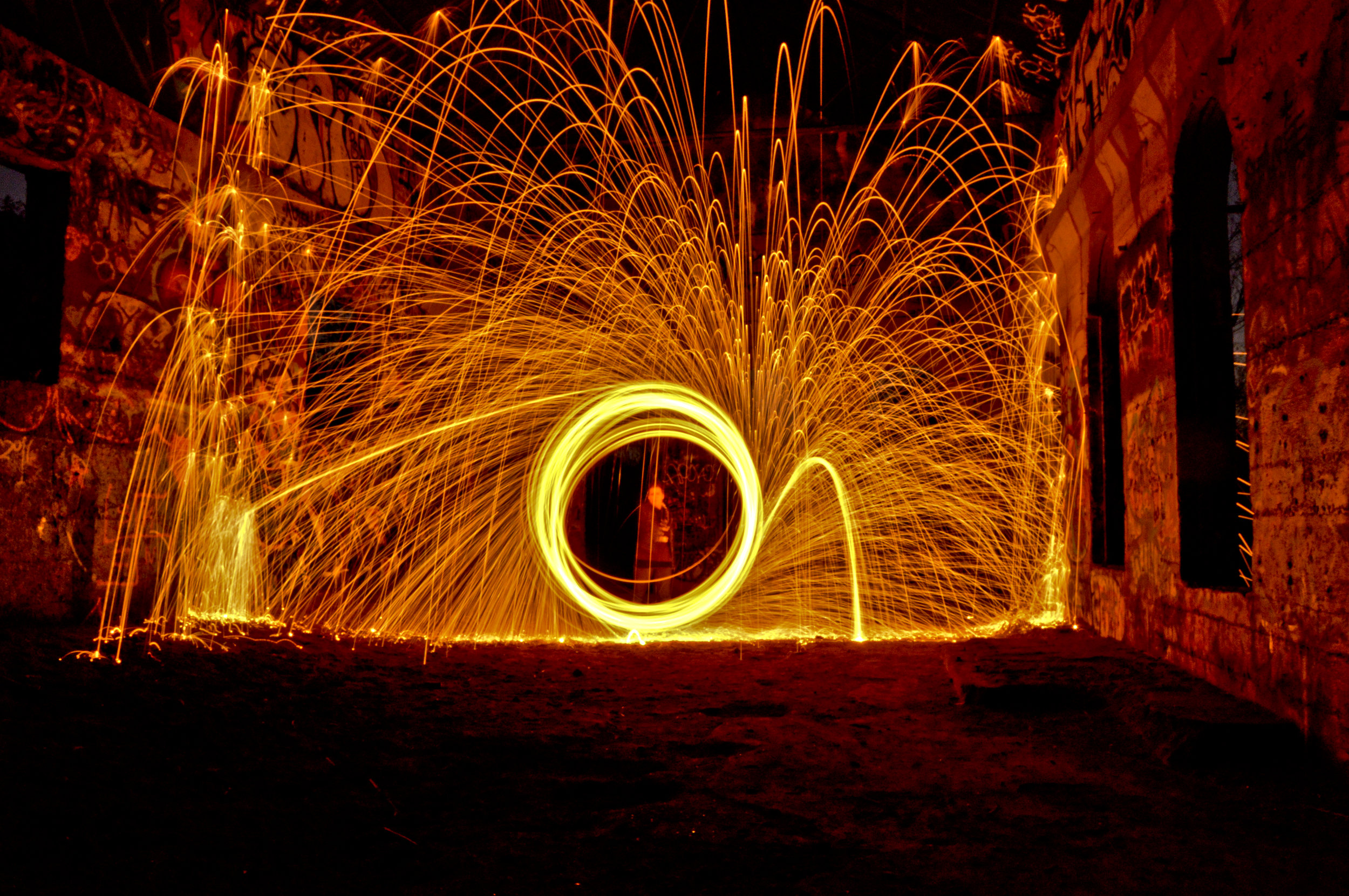Spinning steel wool in an abandoned power house.     Photo: Joshua Stephens