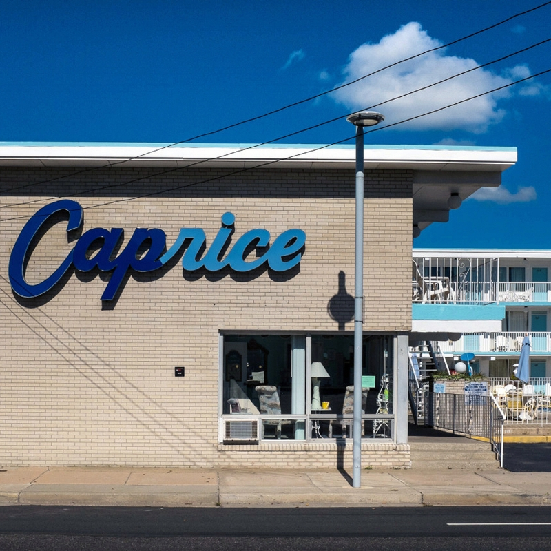 The Caprice Motel, Ocean Ave. Wildwood, NJ. We visited this area in the off season. It was a veritable ghost town so I ran around by myself madly taking photographs. The Caprice is what's termed a 'Doo-Wop' motel, apparently a term used specifically for the brand of Googie architecture found in Wildwood. This dates from the 50s and 60s, a space-age style that I read is more concentrated in Wildwood than almost any other area in the world. The over 50 vintage motels still standing today (of over 100 originals) were designated as the Wildwoods Shore Resort Historic District in the 1990's. Photo: Leah Frances, @americansquares