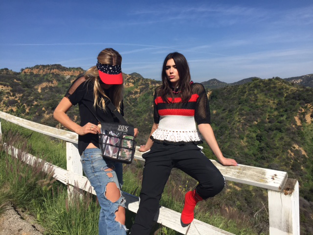 Dua sits patiently as makeup artist Lilly Keys adds some finishing touches between shots. We wanted to capture Dua against LA's natural and iconic landscape, so decided to keep her makeup to a minimum and instead focus on her amazing style.   Dua wears Msgm top and black pants, Vetements socks boots.