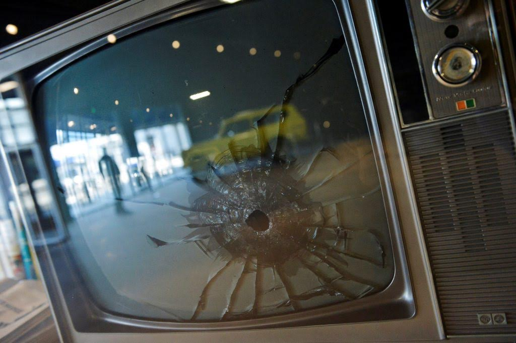 A television with a bullet hole in the screen is one of the items on display at the Elvis Presley complex across the street from his home Graceland. Photo by Brandon Dill/Reuters.