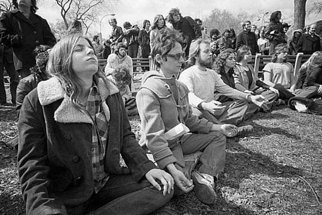 Group meditation in the open air, America.