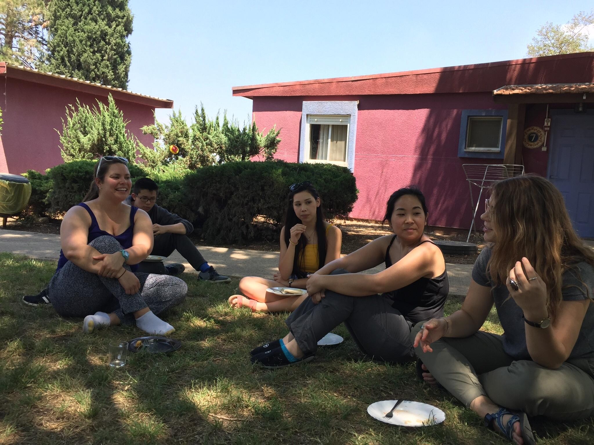Staff enjoy lunch on the lawn