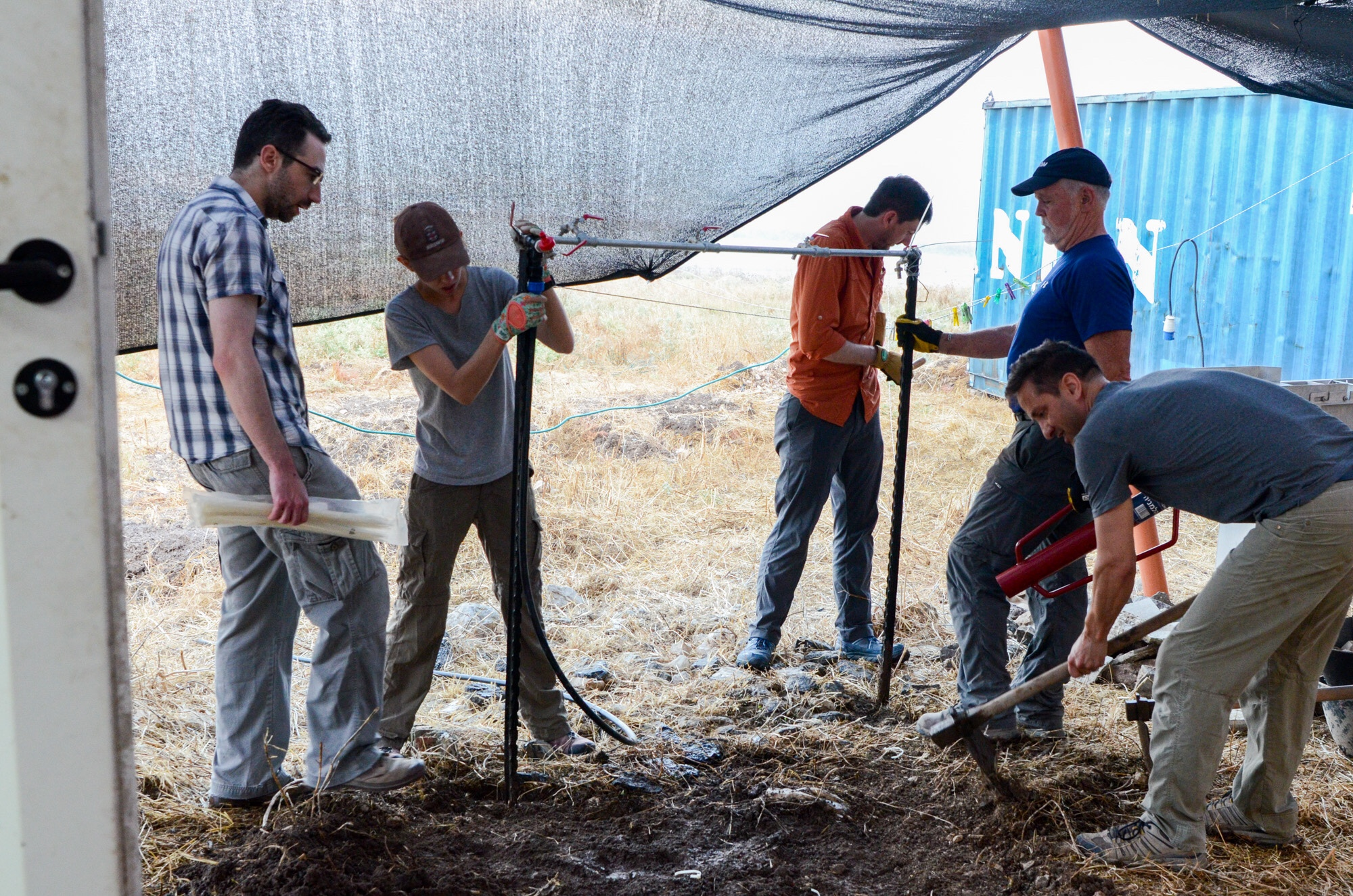 Constructing a pavement for the water spigot in the pottery compound