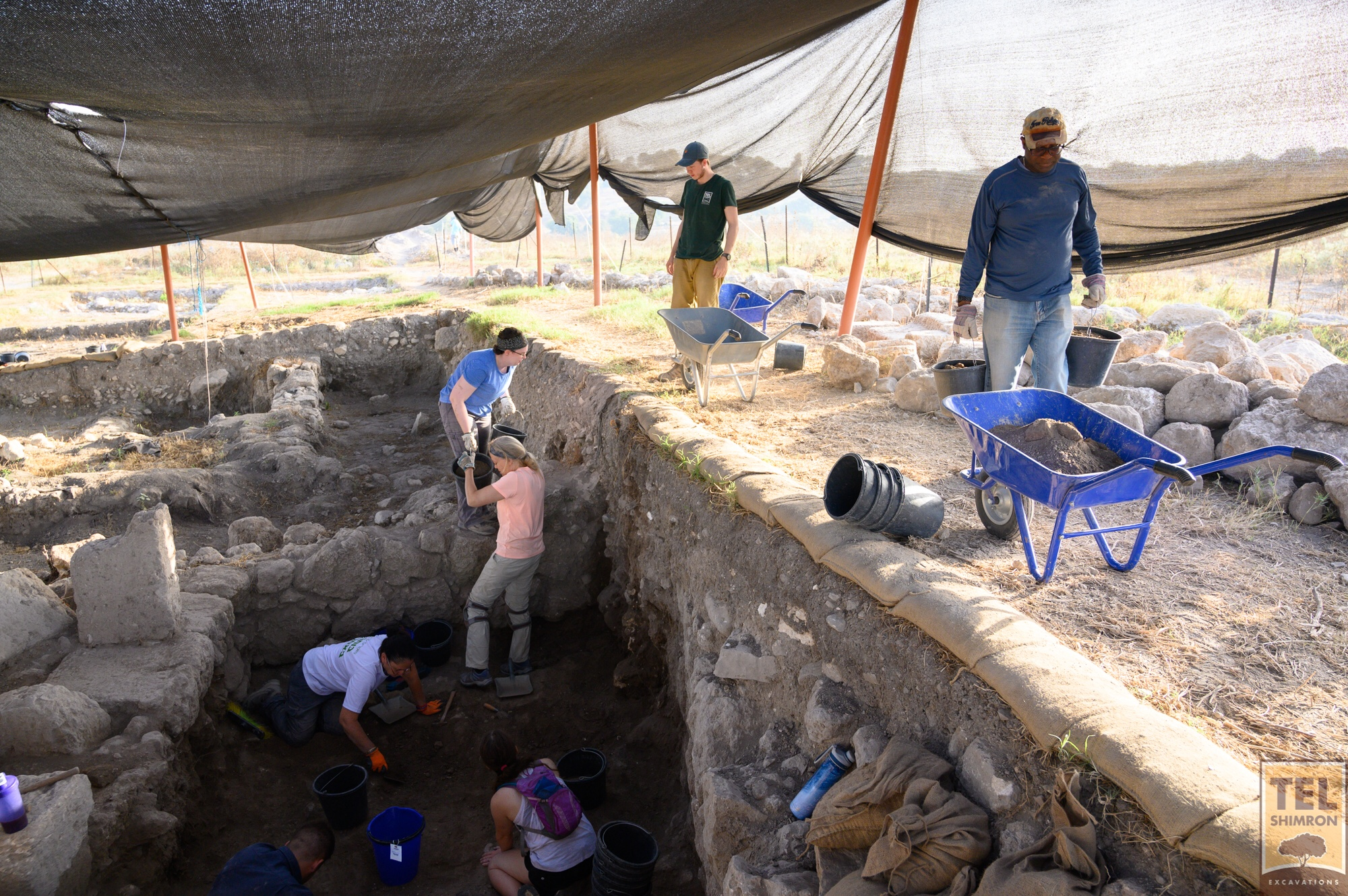 Volunteers in Grid 23/24 trace a stone floor in a Roman period building