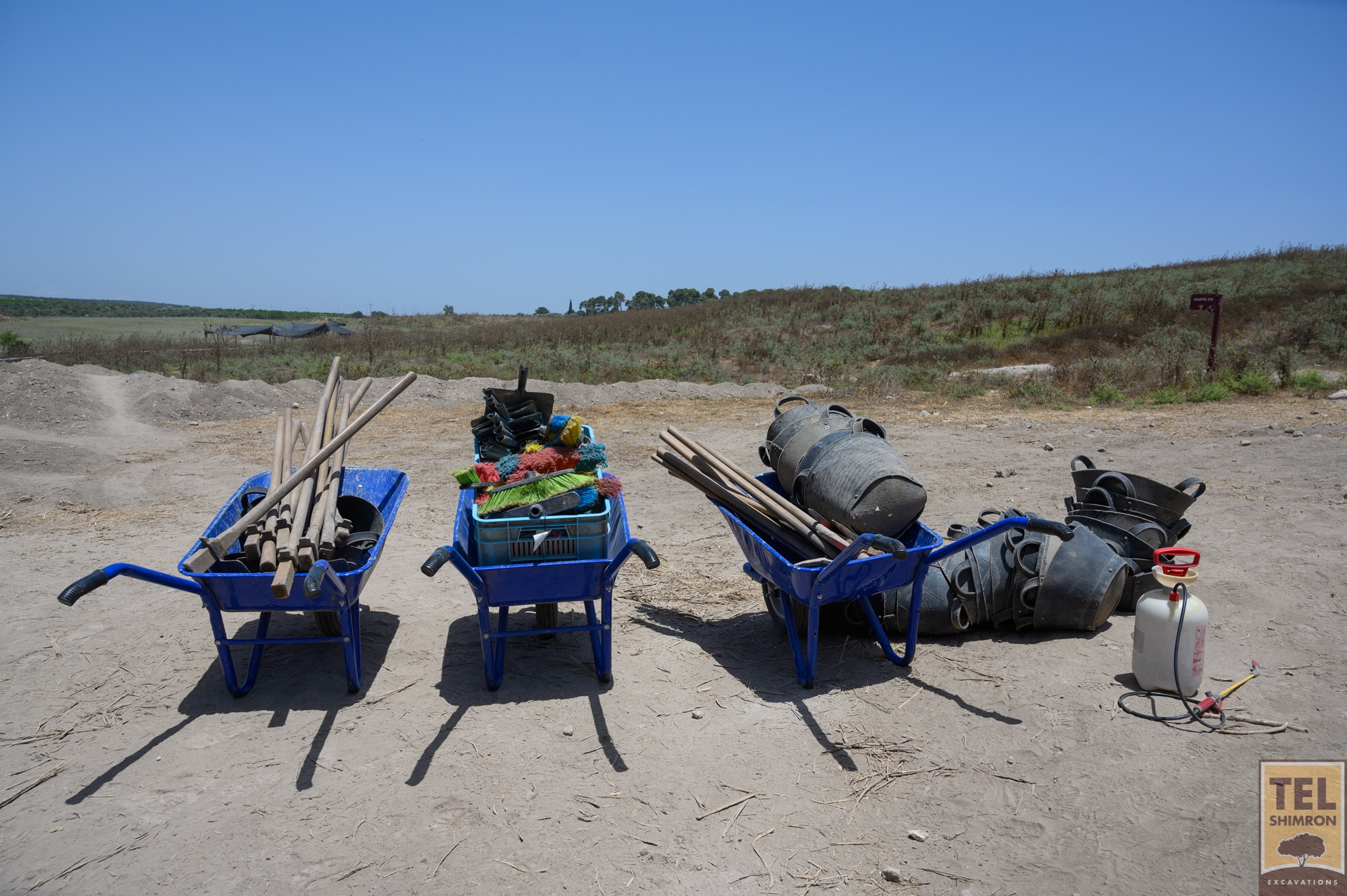 Wheelbarrows waiting to go back to the pottery compound