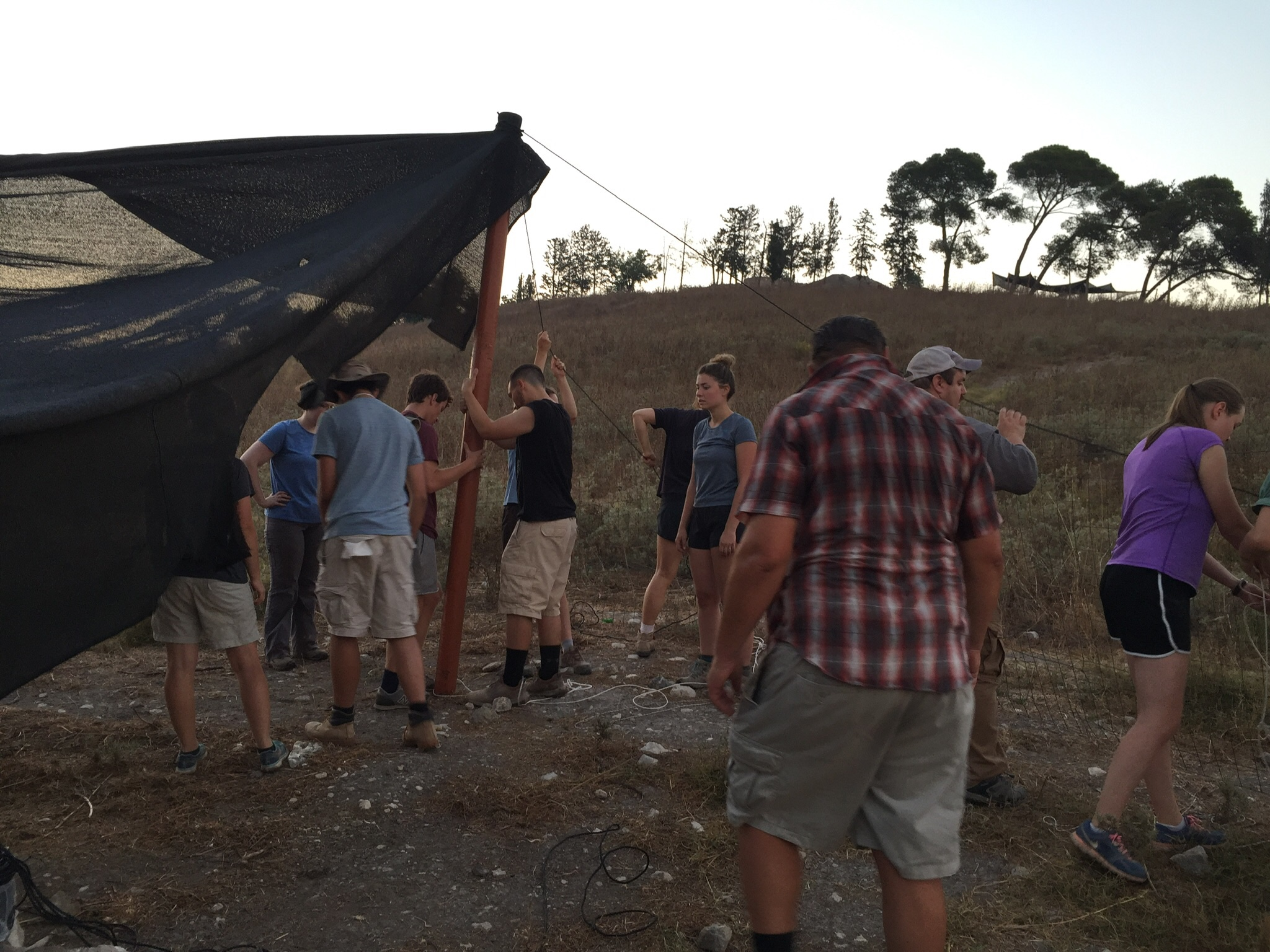 Hanging a 30 x 15 meter shade cloth requires a lot of people