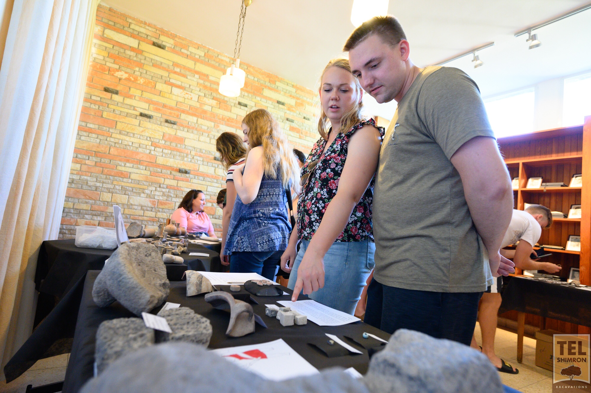 Staff examine artifacts at the Finds Display