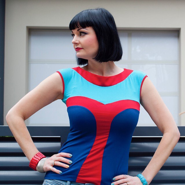 1/3: This style was inspired by pop art- the colours, the super hero red sweetheart t-bar shape, the outline in red around the cap sleeves and neck. It is such a fun top to wear! #artandthen #creativestudy #penelopered @penelopereddesigns