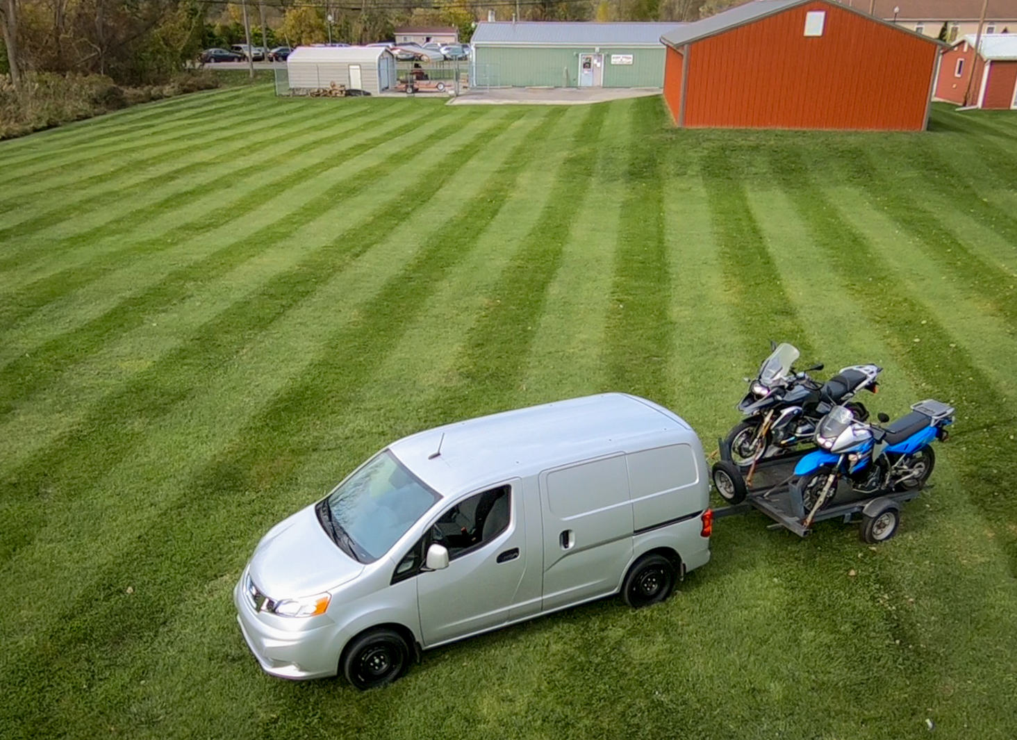 KLR and GS loaded up behind the NV200.