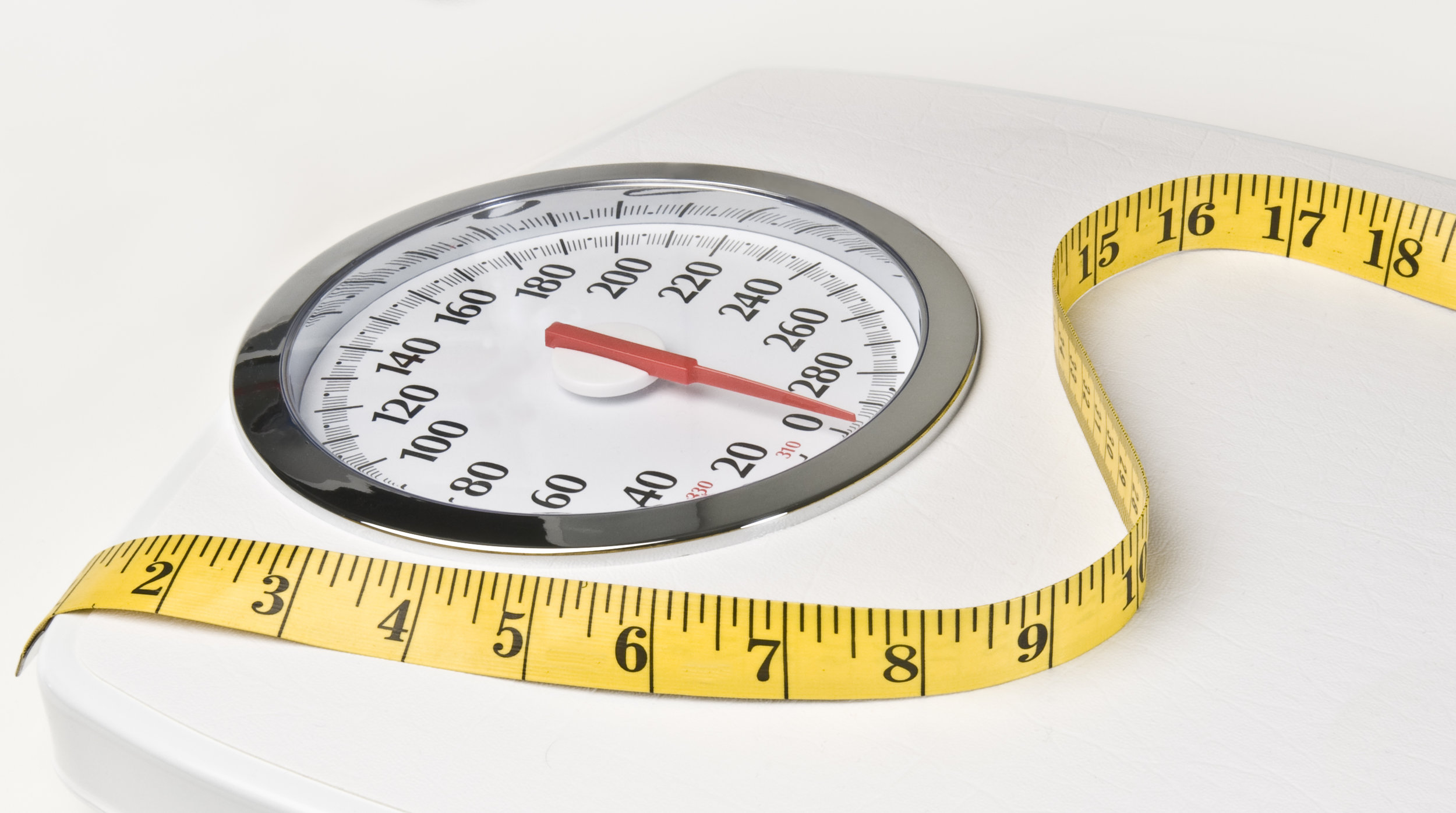 Scale and measuring tape - integrated medicine Tucson