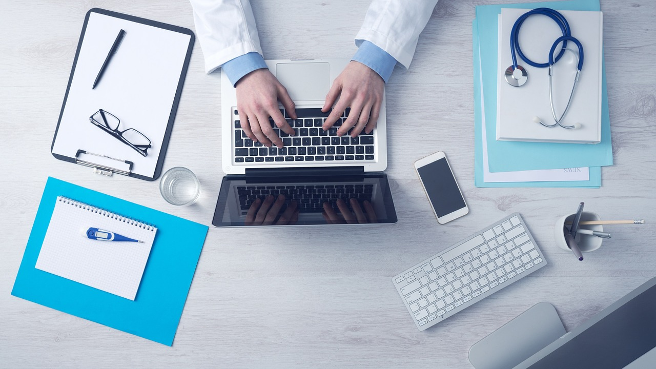 Integrative medicine doctor - computer and accessories on desk