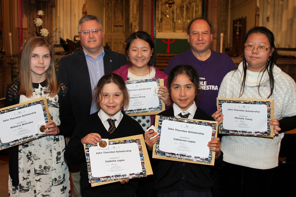Coda Fiddle Orchestra at St Clement's Church, Boscombe ... 13.11.2015 ... photograph by Hattie Miles ...  Geoff Beck, second left, presented John Thornton Music Scholarship Awards,  Jack Maguire founder of the Coda Fiddle Orchestra is second left.