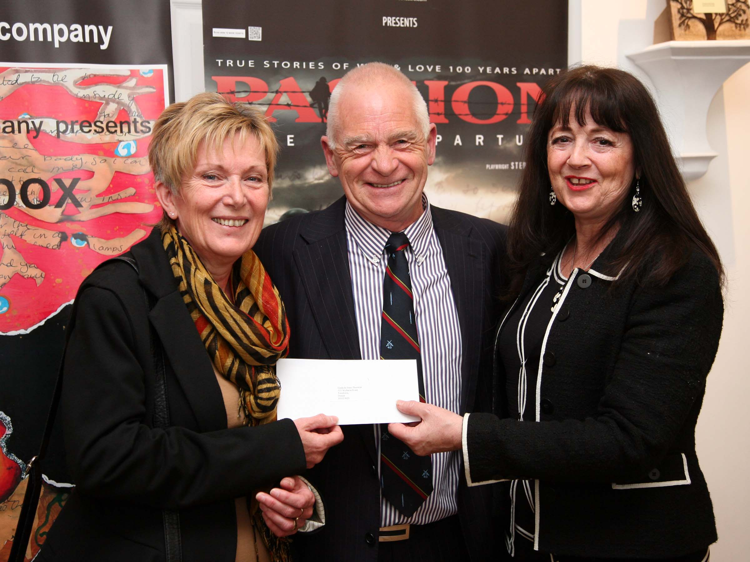 Linda & Peter accept cheque from AsOne