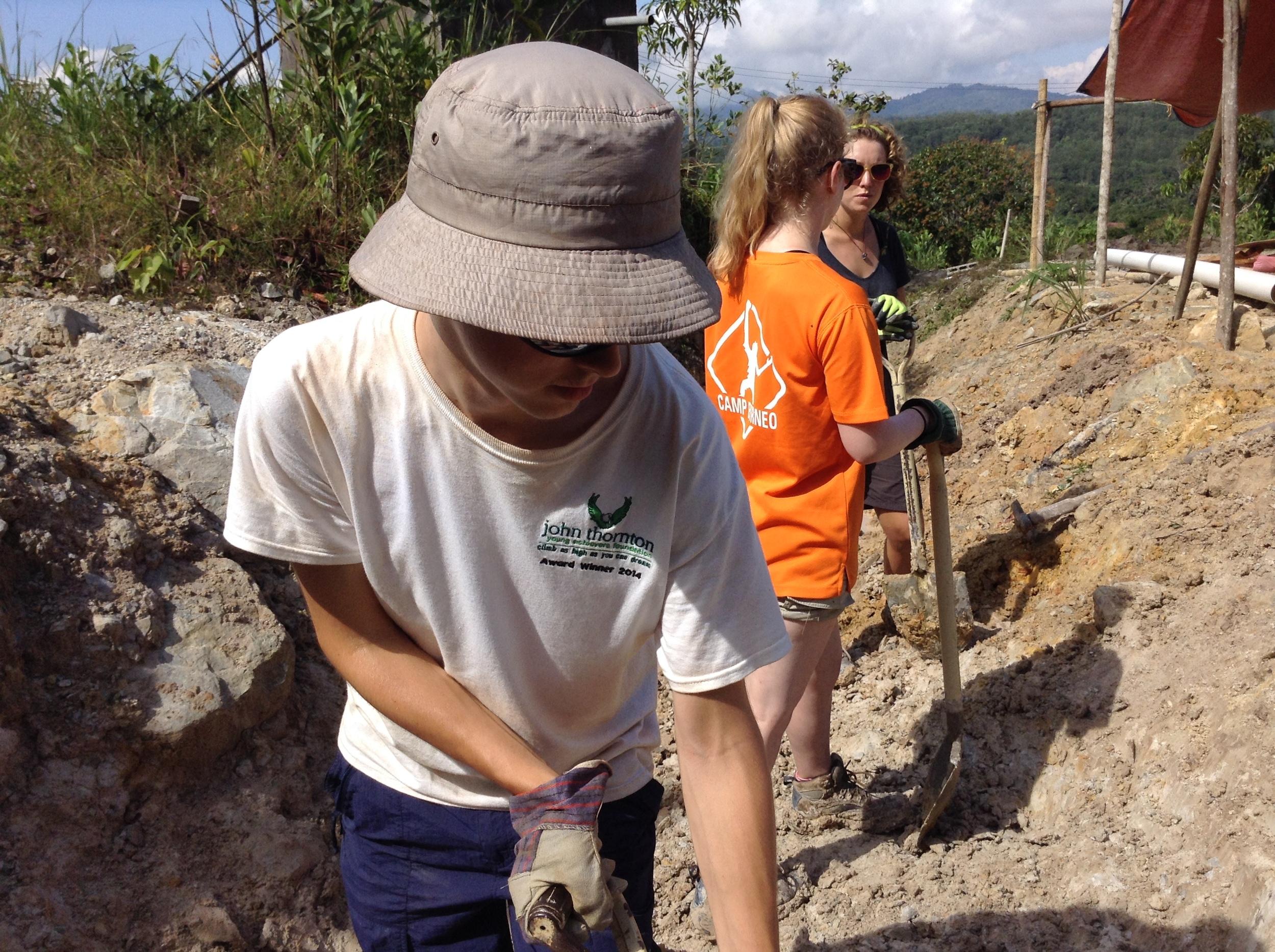 Digging-a-water-drainage-trench-at-Bongkud.jpg