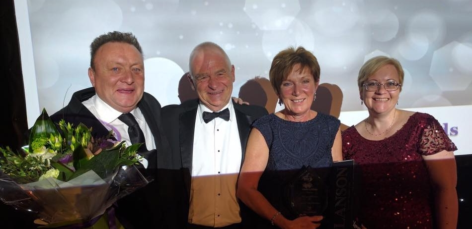 """Linda and Pete Thornton (centre) receiving the """"Making a Difference"""" Award for the JTYAF presented by Tammy Cutler, owner of Cutler & Co HR Consultants and Steve Power, Wave 105."""