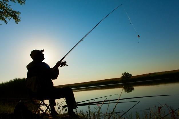 man-fishing-on-a-lake_1004-12.jpg