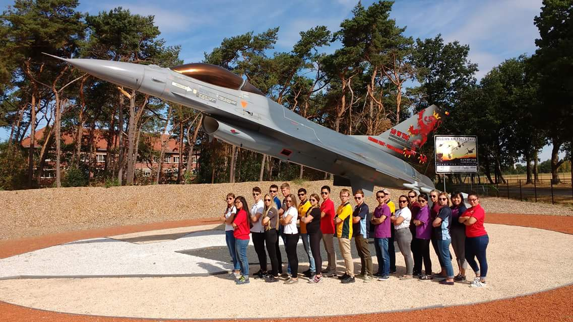 The entire IACE Belgium group posing in front of a F16 at the Air Base of Kleine Brogel