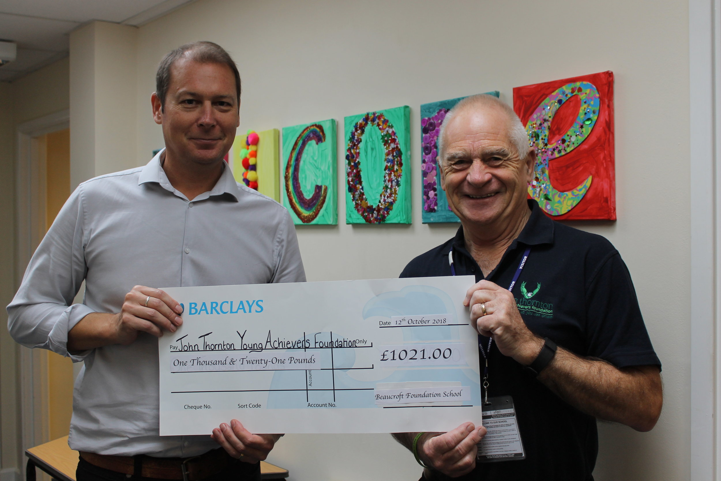 Beaucroft Headteacher Joe Barnett presenting the big cheque to JTYAF Chairman Pete Thornton.