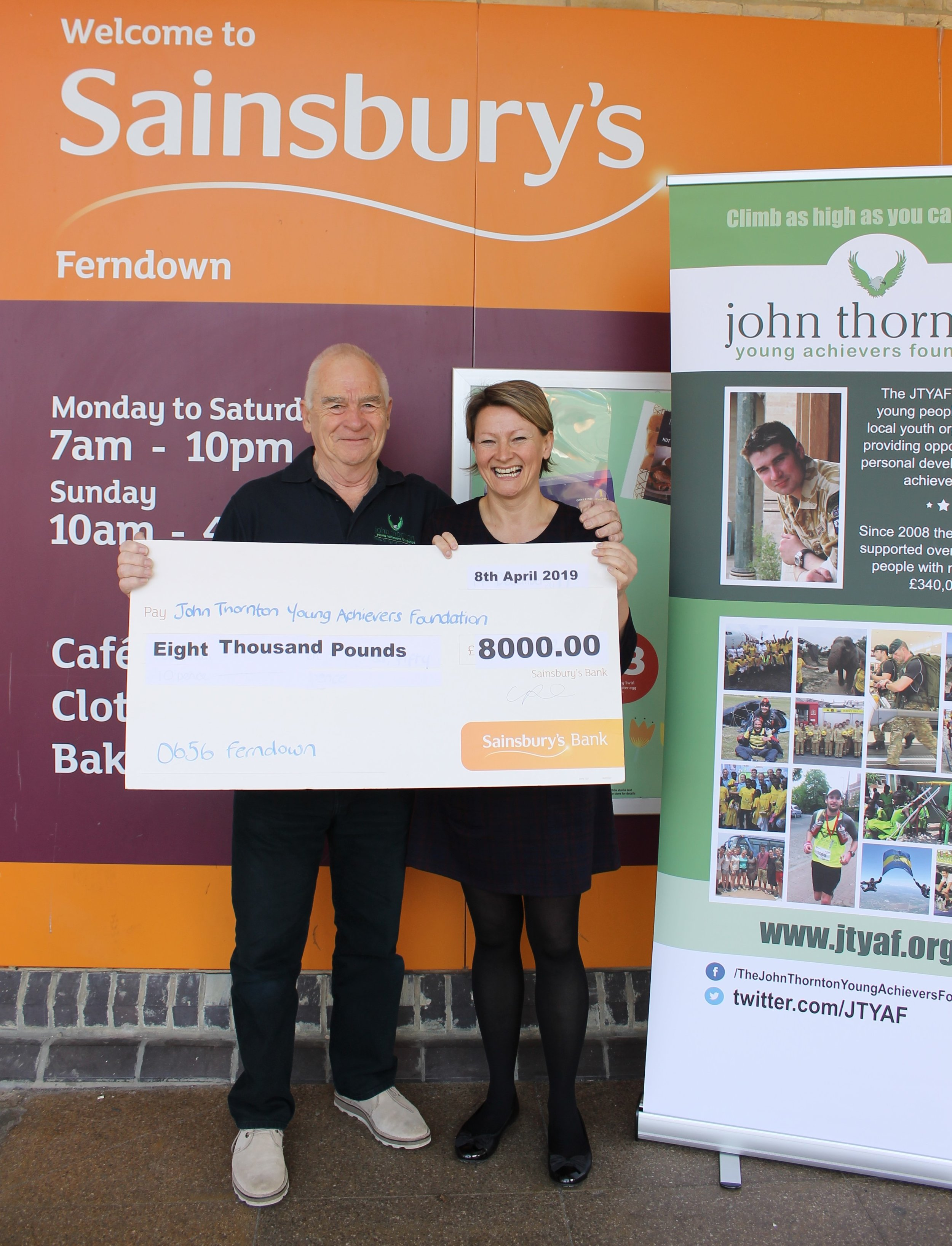 Kerry presenting the big cheque to Pete Thornton, Chairman of the JTYAF