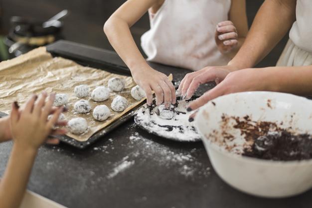 two-sisters-mother-preparing-chocolate-cookie-kitchen_23-2148044385.jpg